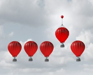 red parachute balloons with competition concept
